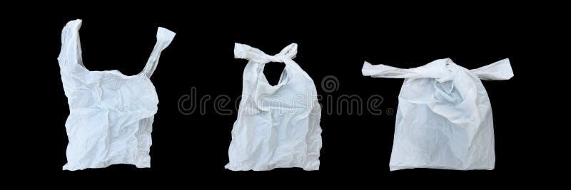 открытый, связь и полиэтиленовый пакет конца белый изолированный на черноте стоковая фотография