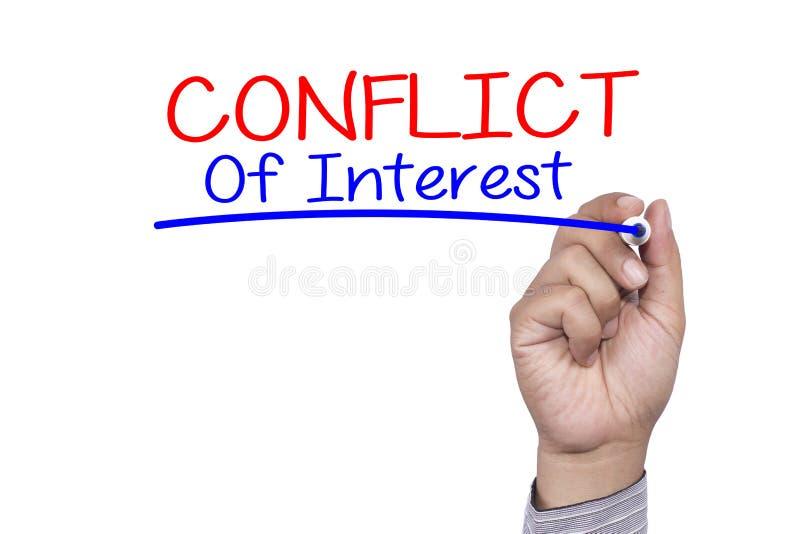 Отметка почерка концепции дела и пишет конфликт интересов стоковое изображение
