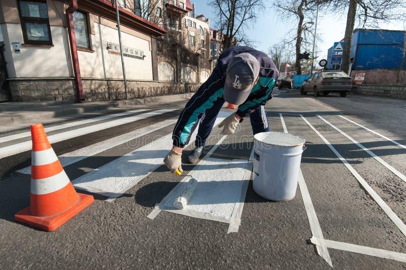 Отмечать работа на расположении пешеходного перехода стоковая фотография rf