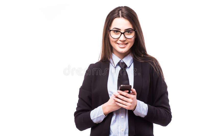 Отправка СМС коммерсантки стоковое фото rf