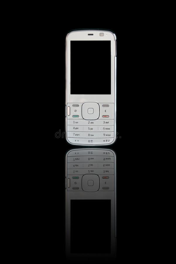 отражение мобильного телефона предпосылки черное стоковая фотография rf