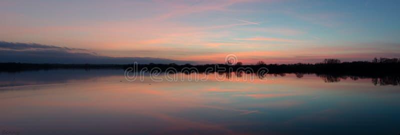 Отражения захода солнца стоковые фотографии rf