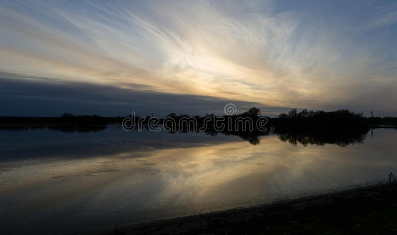 Отражения захода солнца стоковая фотография rf