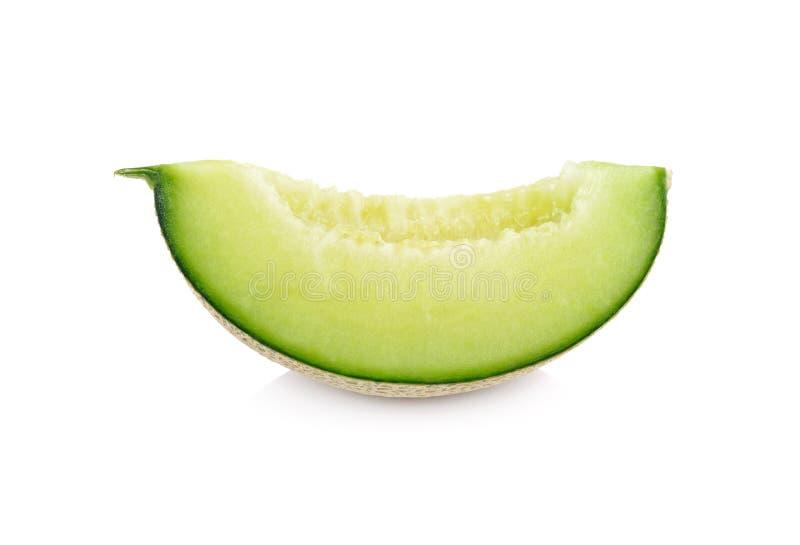 Отрежьте дыню зрелого сладкого honeydew части зеленую на белой предпосылке стоковые изображения