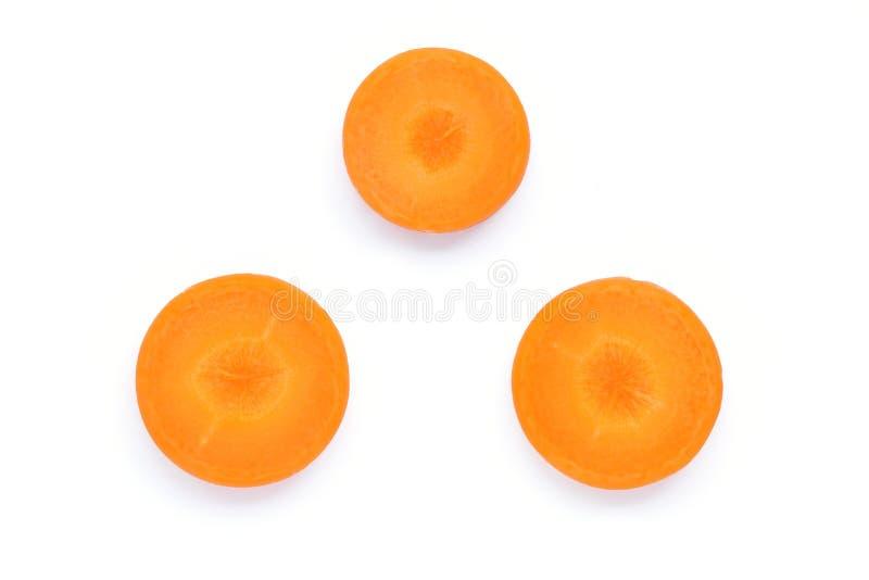 Отрезанная оранжевая морковь изолированная на белой предпосылке стоковые изображения