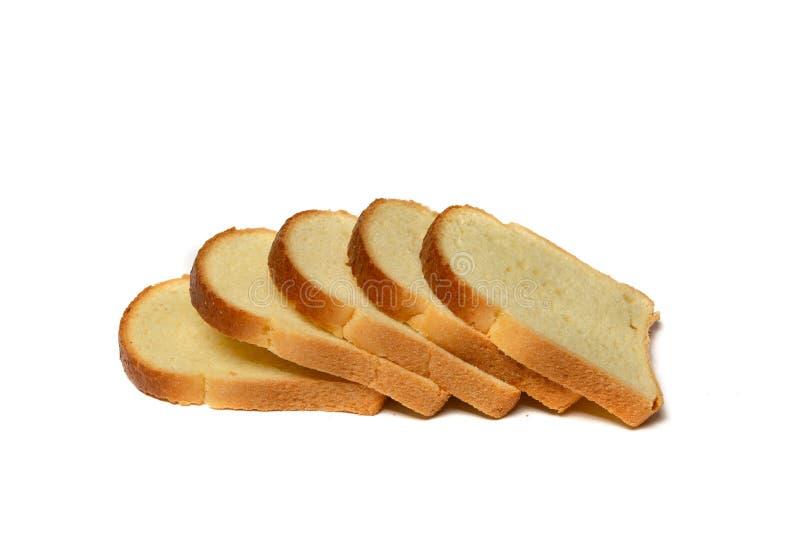 Отрезанный белый хлеб на белой предпосылке стоковая фотография rf