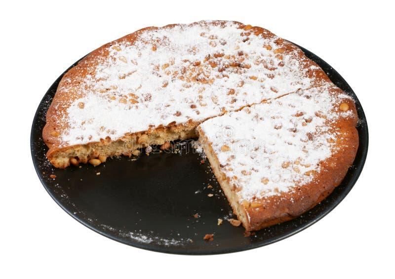 отрезанный итальянский торт гайки сосны на плите отрезал вне стоковая фотография