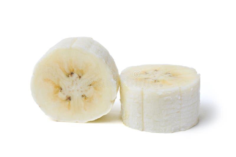 Отрезанный, который слезли банан изолированный на белой предпосылке стоковое фото