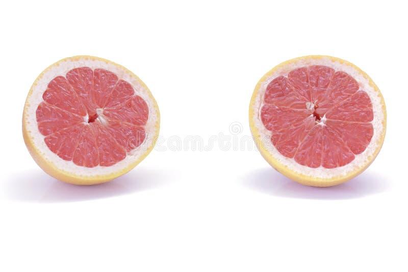 Отрезанный розовый грейпфрут изолированный на белой предпосылке стоковая фотография rf