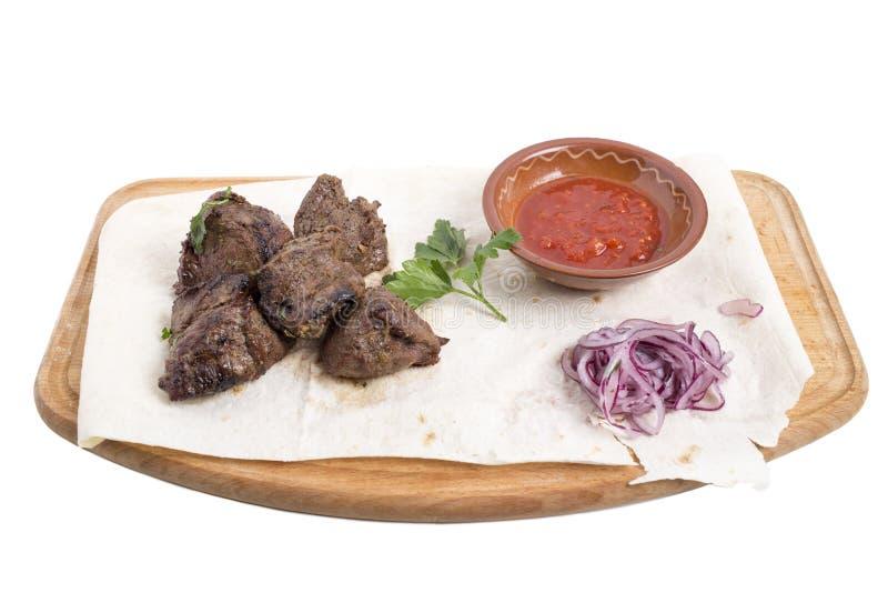 Отрезанный стейк говядины с томатным соусом стоковое фото rf