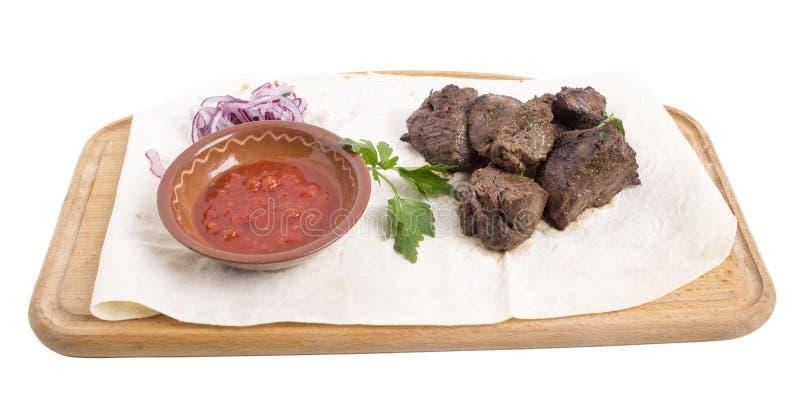 Отрезанный стейк говядины с томатным соусом стоковая фотография rf