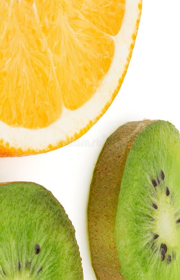 Отрезок плода апельсина и кивиа в кольца закрывает вверх стоковое фото rf