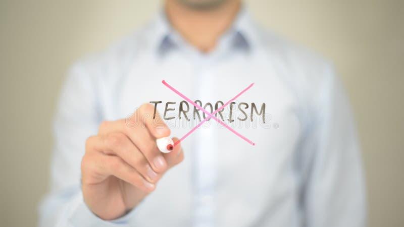 Отсутствие терроризма, сочинительства человека на прозрачном экране стоковые изображения rf