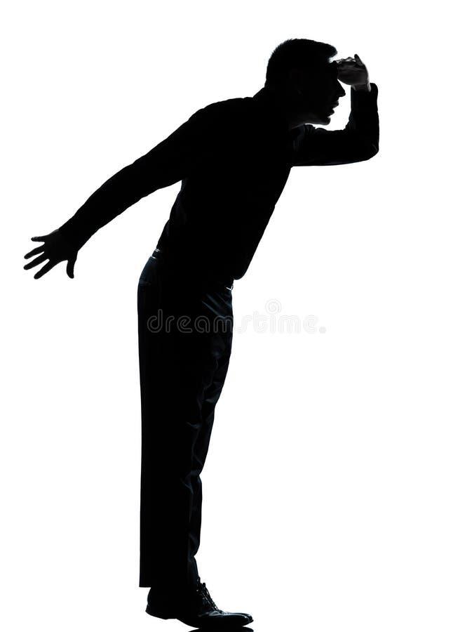 отсутствующее дело смотря tiptoe силуэта человека одного стоковое фото rf