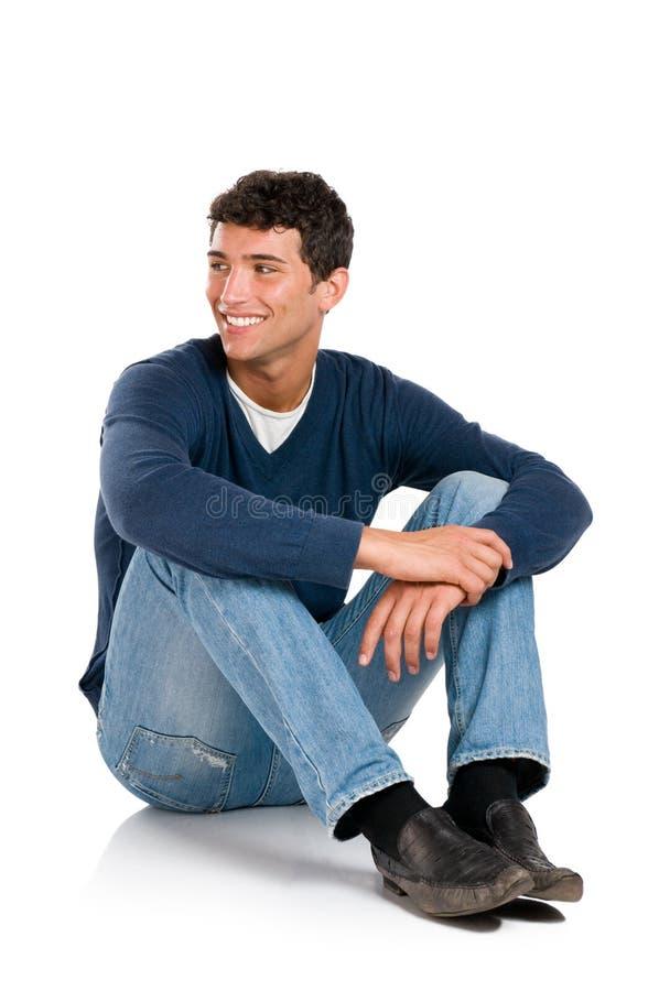 отсутствующий смотря усмехаться человека стоковая фотография