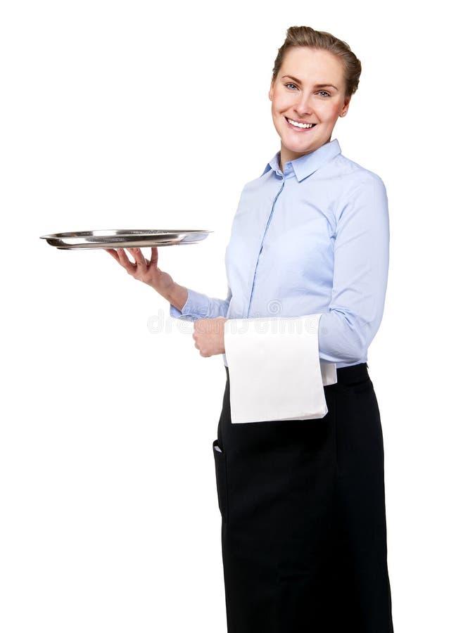Официантка держа поднос изолированный над белой предпосылкой усмехаться стоковая фотография rf