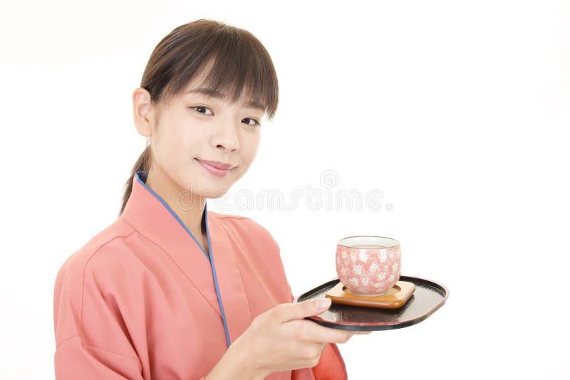 Официантка японского ресторана стоковые изображения