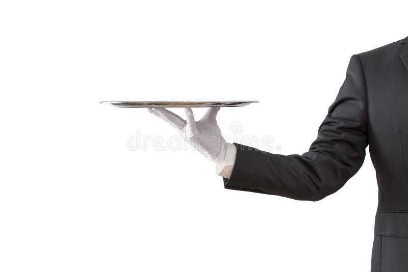 Официант держа пустой серебряный поднос стоковые изображения