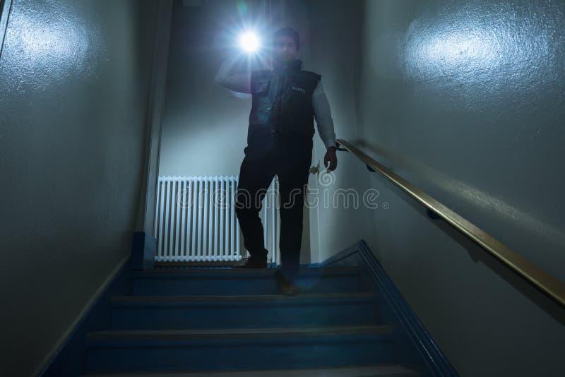 Охранник стоя близко лестница стоковое фото rf
