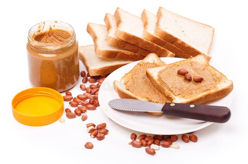 Очень вкусное арахисовое масло на таблице стоковое фото rf