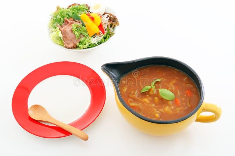 Очень вкусное карри с салатом стоковое фото rf