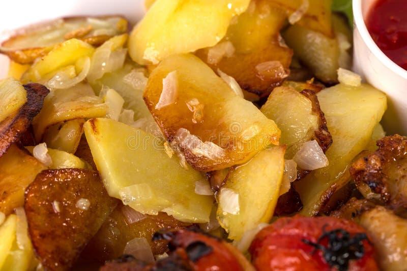 Очень вкусные зажаренные в духовке картошки стоковое изображение rf