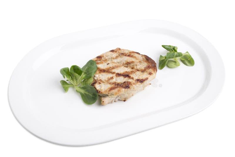 Очень вкусный стейк свинины в белой плите стоковые изображения