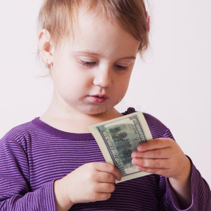 Очень счастливый ребёнок дела с банкнотой доллара стоковое изображение rf