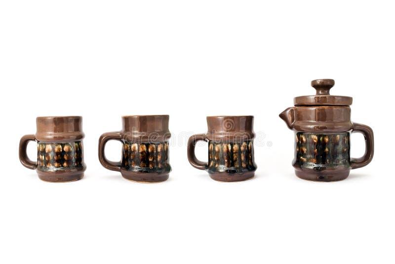 очередь придает форму чашки чайник стоковые изображения rf