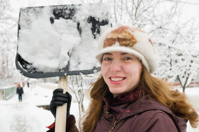очищает женщину снежка стоковое фото