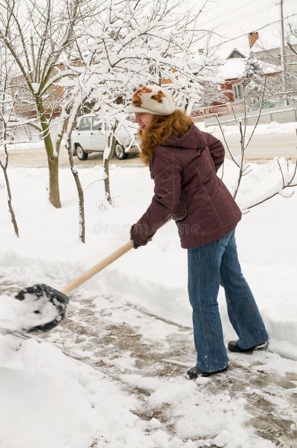 очищает женщину снежка стоковое фото rf