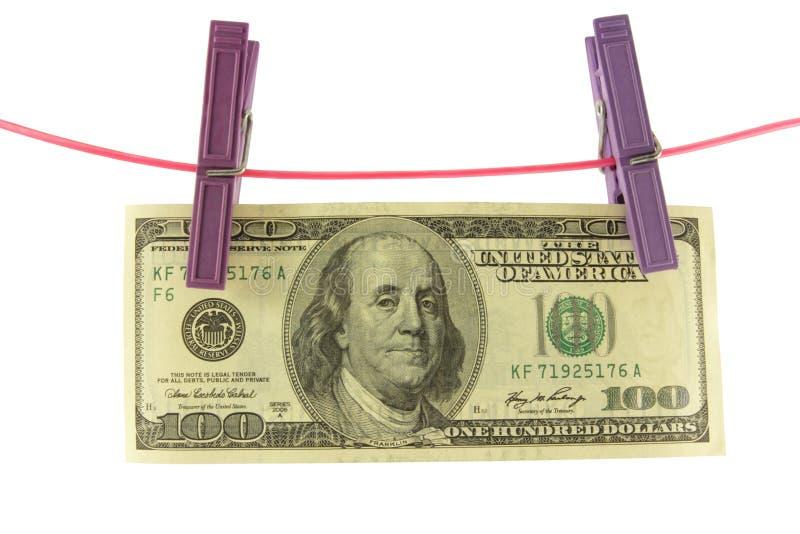 100 долларов для 2 зажимок для белья на шнуре стоковые изображения rf