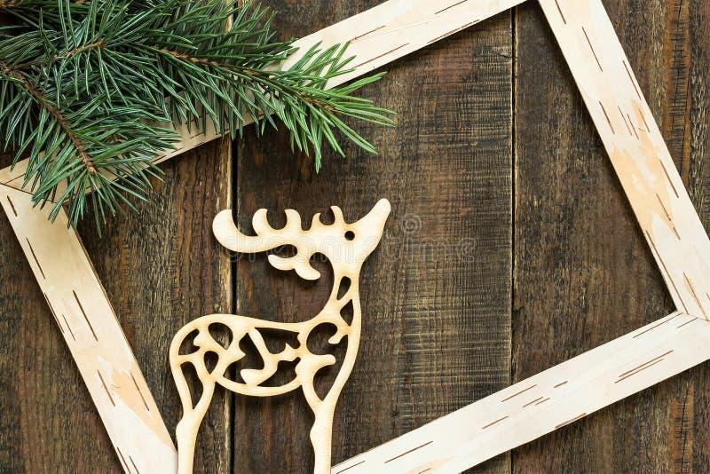 Олени свежие елевые ветви, рамка и украшение рождества стоковое фото