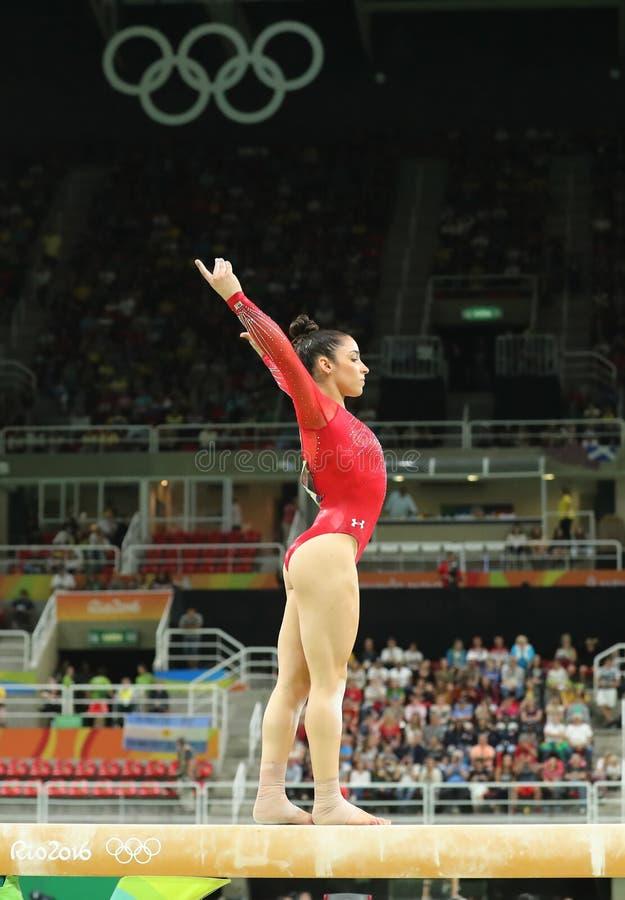 Олимпийский чемпион Aly Raisman Соединенных Штатов состязается на коромысле на женщинах все-вокруг гимнастики на Рио 2016 стоковое фото