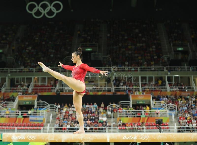 Олимпийский чемпион Aly Raisman Соединенных Штатов состязается на коромысле на женщинах все-вокруг гимнастики на Рио 2016 стоковая фотография