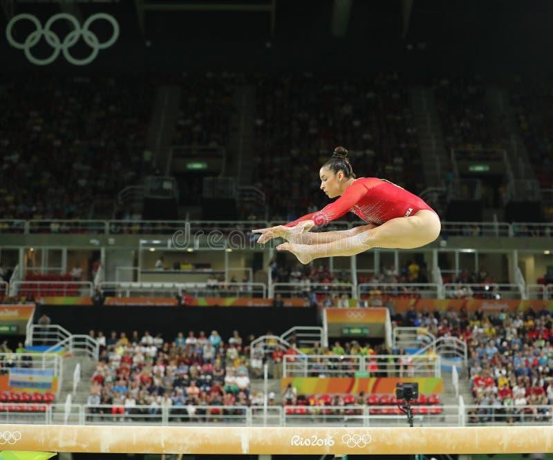 Олимпийский чемпион Aly Raisman Соединенных Штатов состязается на коромысле на женщинах все-вокруг гимнастики на Рио 2016 стоковая фотография rf