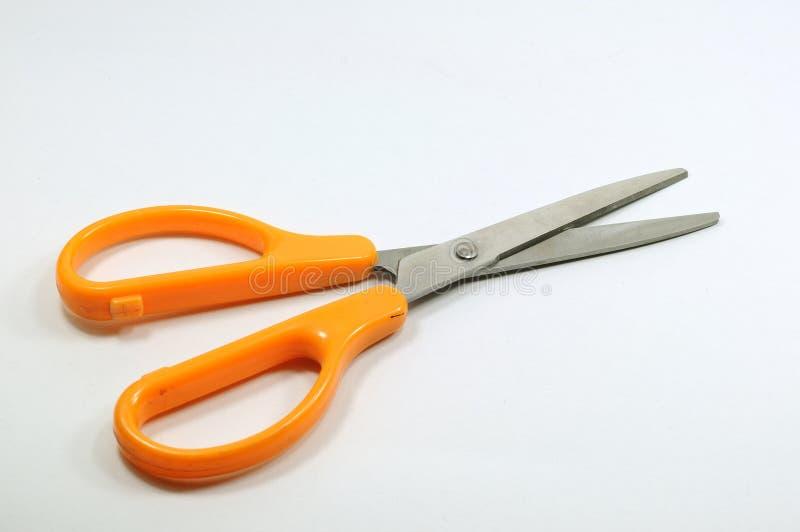 Одиночный scissor с оранжевой ручкой неподвижно стоковые изображения