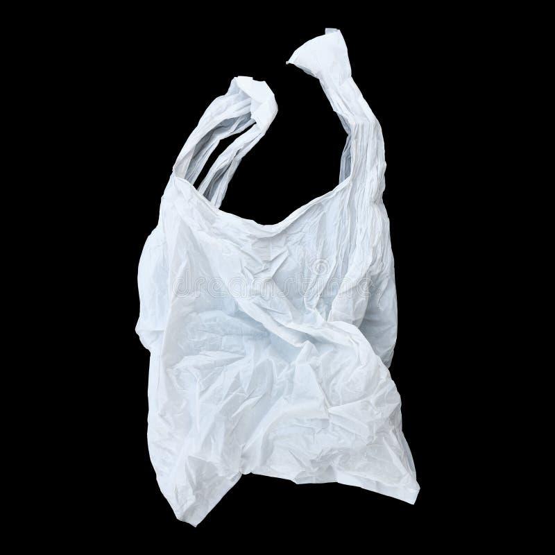 один белый полиэтиленовый пакет изолированный на черноте стоковая фотография rf