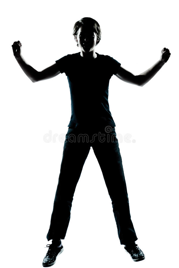 Один молодой силуэт мальчика или девушки подростка счастливый стоковая фотография rf