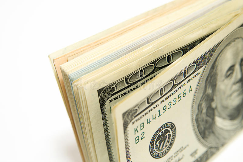 Один пакет долларов США дальше над белизной стоковые изображения rf
