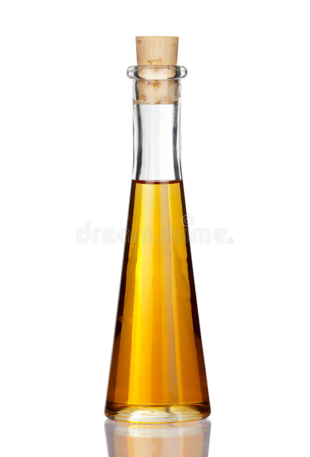 Одна бутылка масла макового семенени с реальным отражением стоковая фотография rf