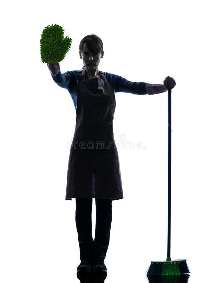 Домашнее хозяйство горничной женщины brooming силуэт жеста стопа стоковое фото