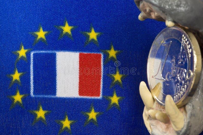 Одна монетка евро, флаг Франции стоковое фото