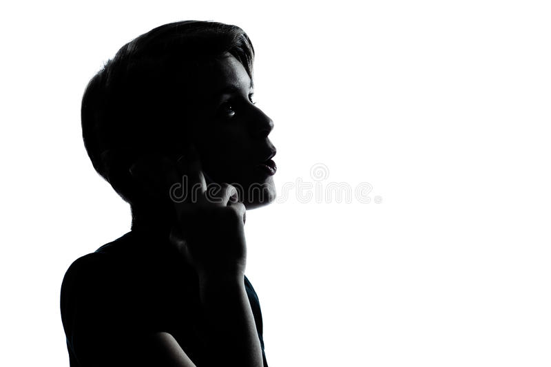 Одна молодые мальчик или девушка подростка на телефоне стоковая фотография