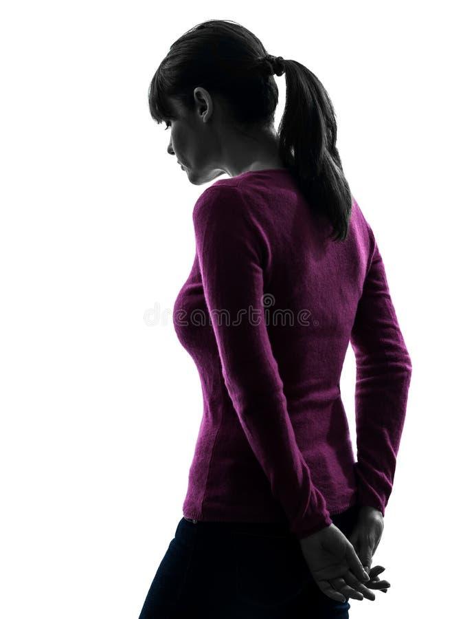 Силуэт вид сзади женщины унылый унылый стоковые фотографии rf