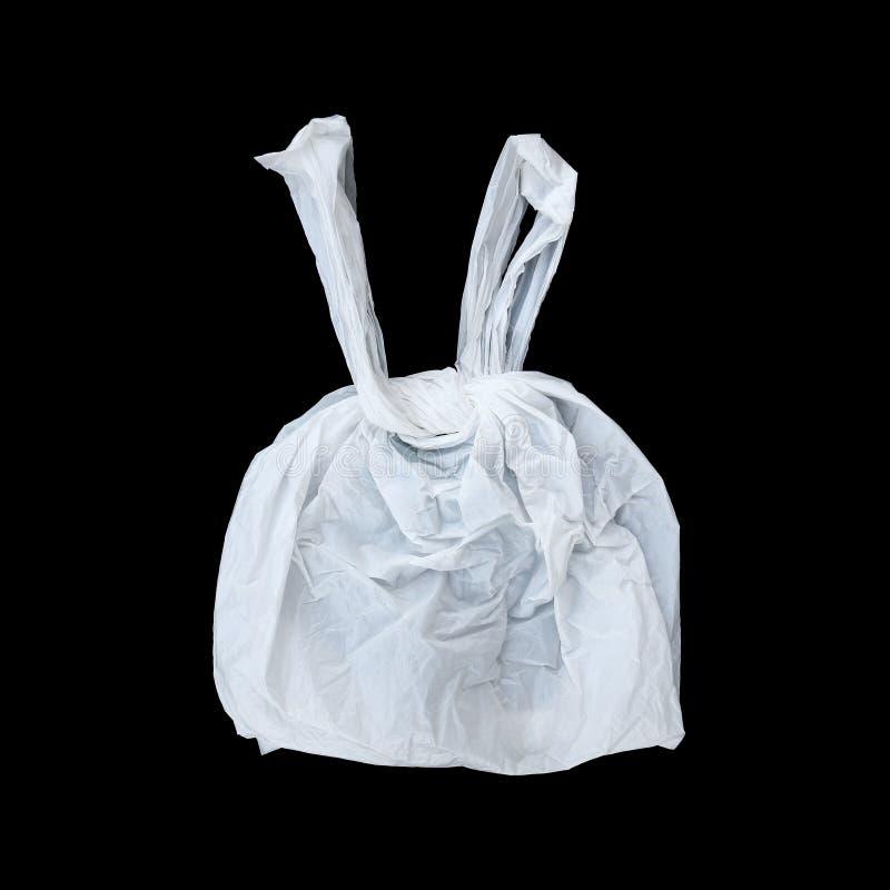 одно связало белый полиэтиленовый пакет изолированный на черноте стоковая фотография