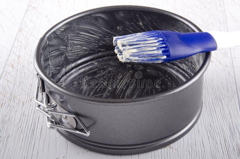 Олово выпечки смазано с маслом стоковое изображение