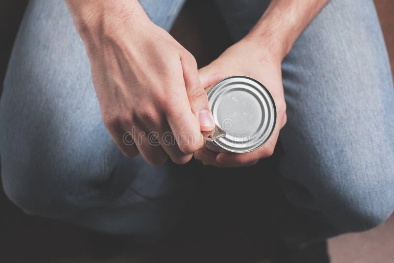 Олово отверстия человека стоковое изображение