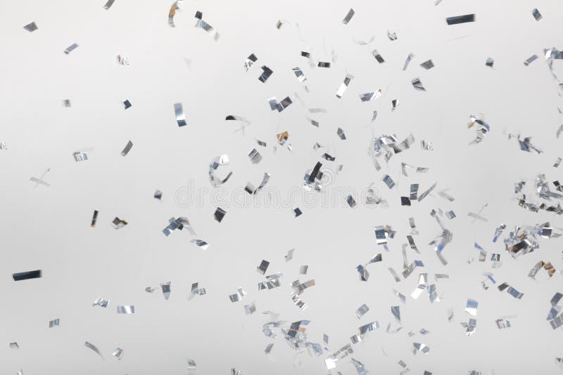 Падая серебряные части confetti стоковая фотография rf