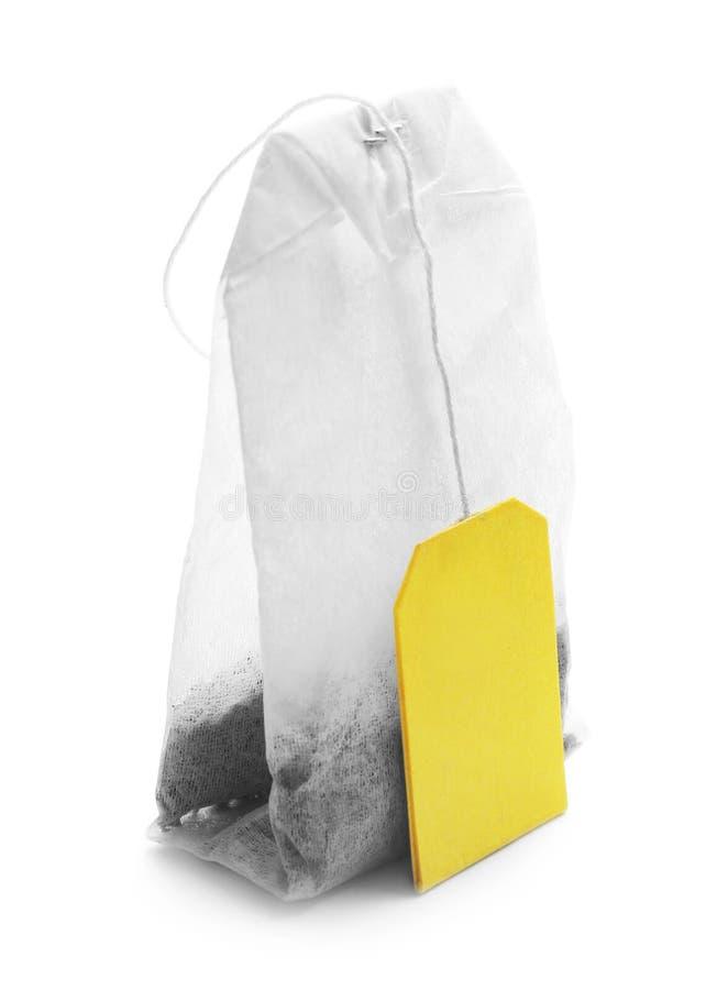 Пакетик чая на белой предпосылке стоковое изображение